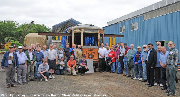 Members & friends pose with Type 5 No. 5706 on June 14, 2009 at Rail Technical Services in Guilford, CT. Here, two hydraulic jacks support the roof while the end vestibule is rebuilt.