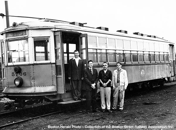 Left to right, Paul Harling, D. Robert McCarthy, Marshall Simmons and Bernard B. Gould, Jr. pose next to 5706 at Everett Shops on July 15, 1959.